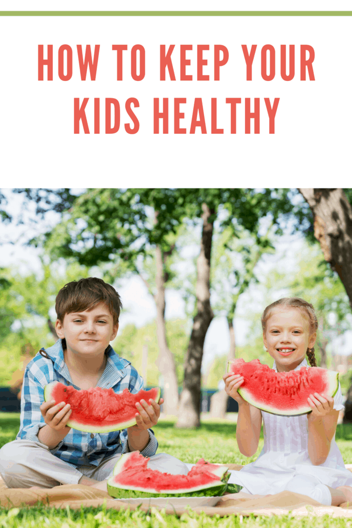 brother and sister eating huge watermelon sliced outside