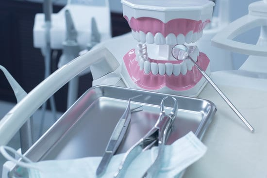 Dentistry, medical equipment of dental instruments, Dental instruments, dental equipment, in the dental clinic. Have mannequin figures in picture.
