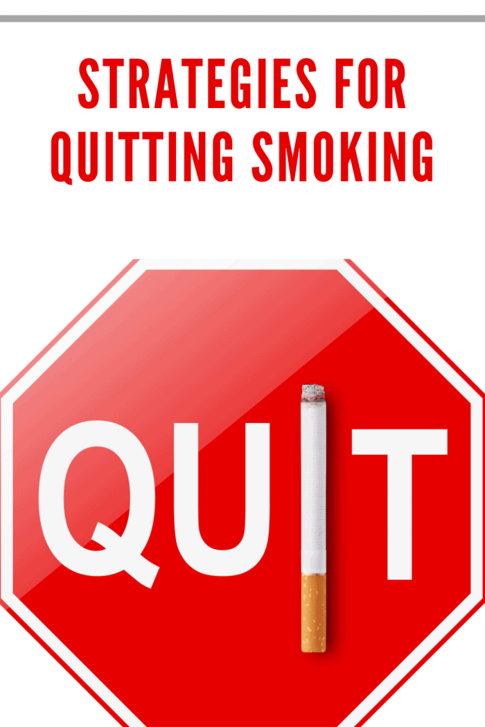 red octagon with word Quit in white. The letter I in quit is replaced with a cigarette