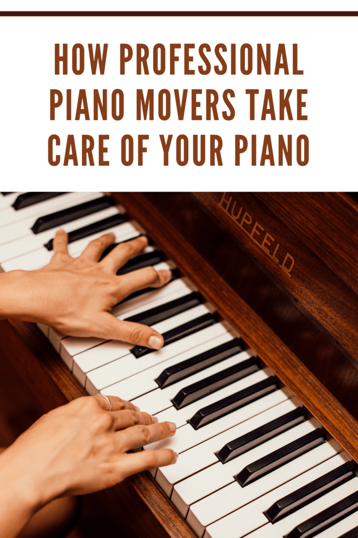brown piano with hands playing piano keys