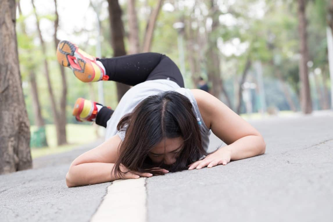 woman who has fallen down while running