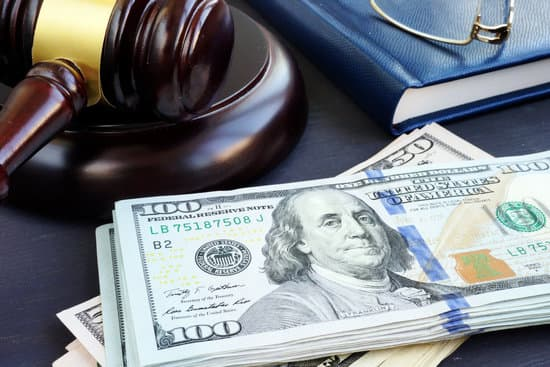 Litigation finance. Gavel and dollar banknotes. Bail bonds.