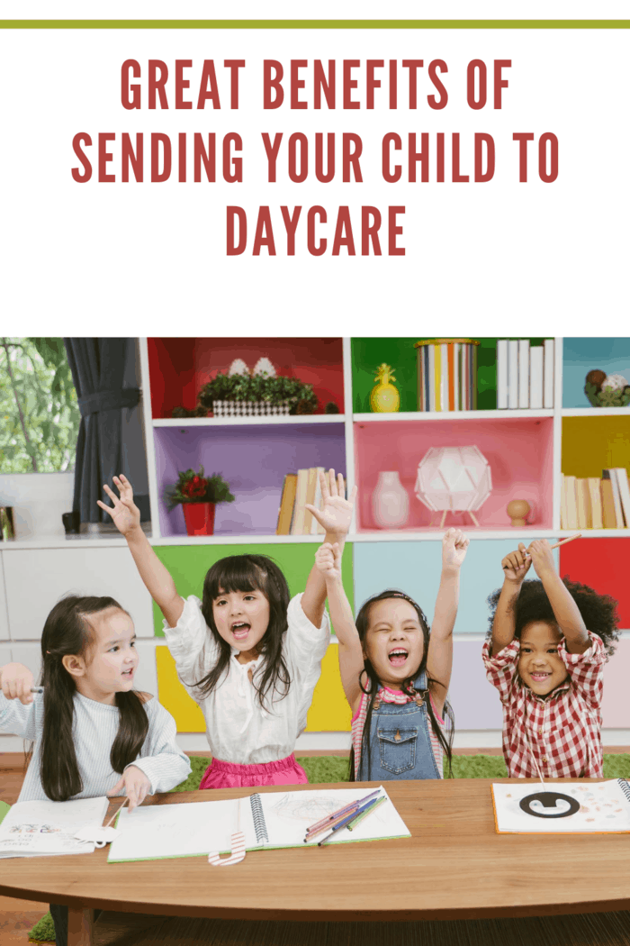 children at daycare raising hands for lesson