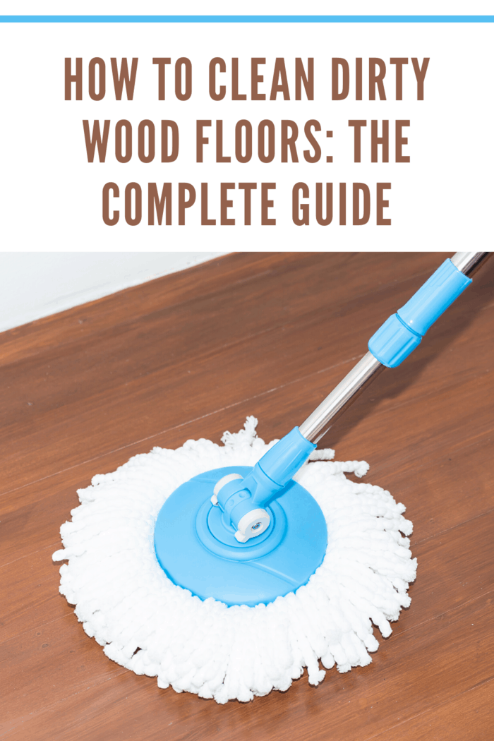 Cleaning dirty wood floors by use modern mop on laminated wood floor.
