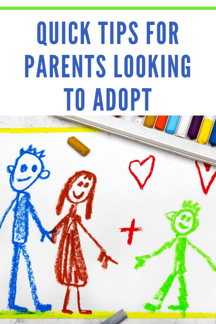 crayon drawing of mom and dad with a child being adopted