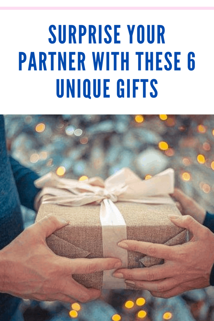 partners gifting a simple box wrapped in brown paper and tied with a pale blush ribbon