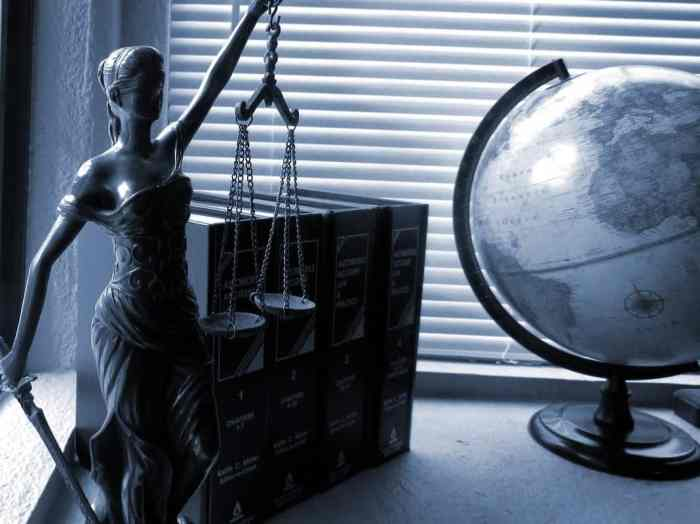 lady justice next to globe in office