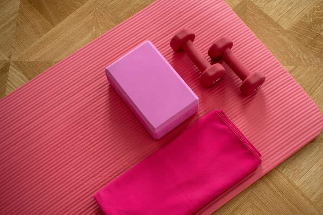 pink exercise mat with weights
