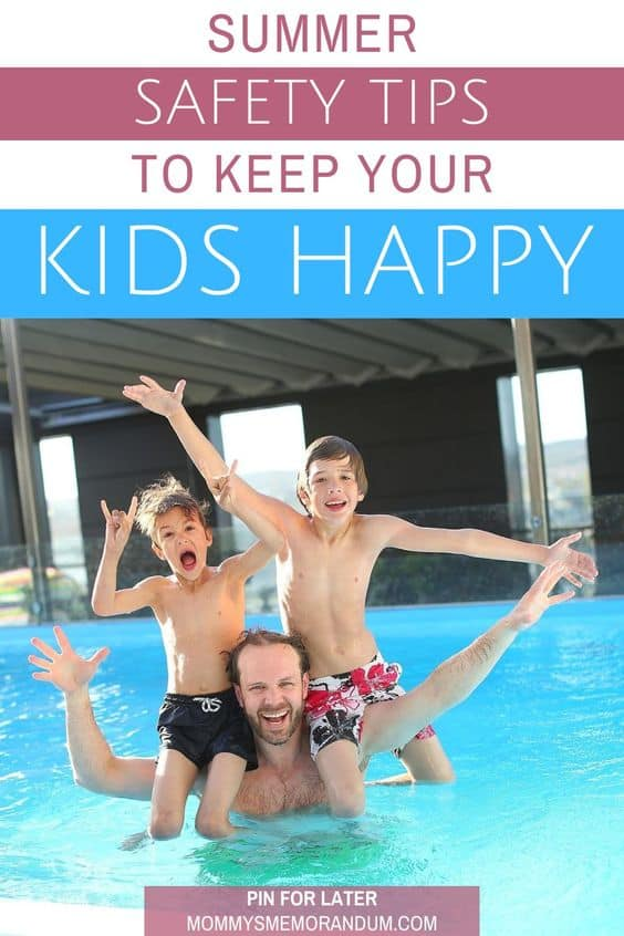 father with two sons on his shoulder in pool posing for camera