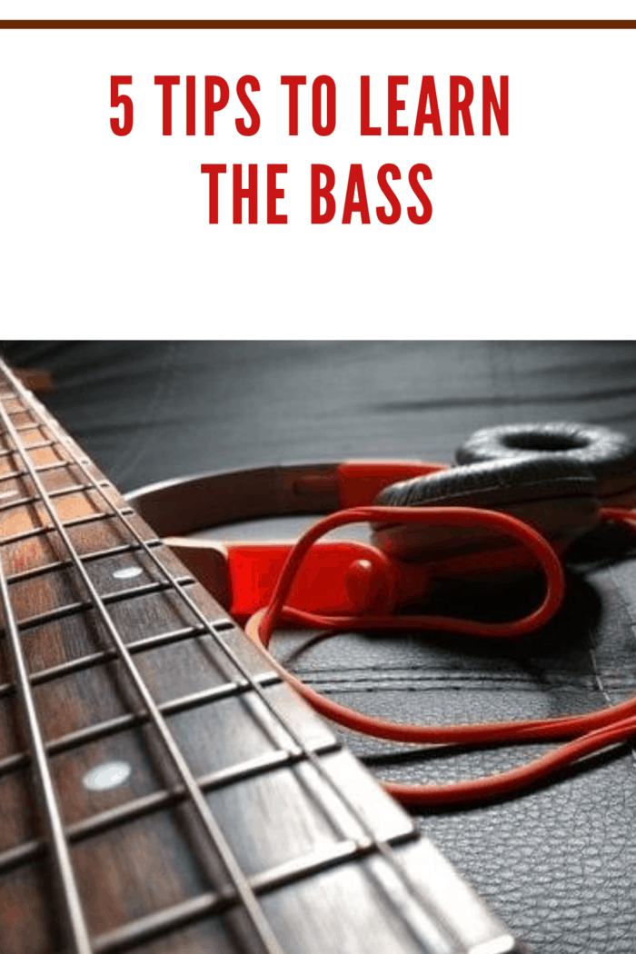 arm of bass with red headphones
