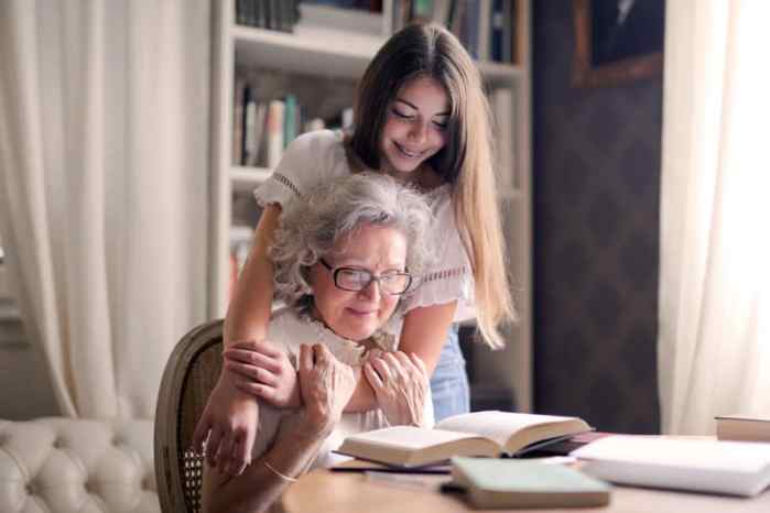 Photo of Woman Embracing Her Grandmother as the read on finding someone to care for your grandparents