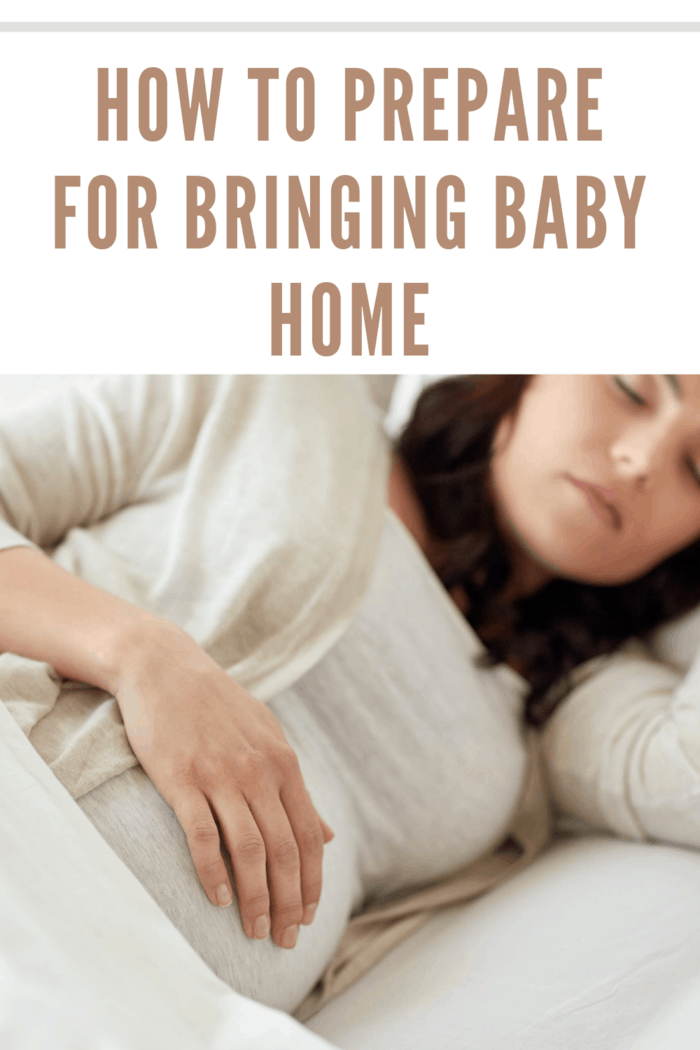 Pregnant woman sleeping in bed at home