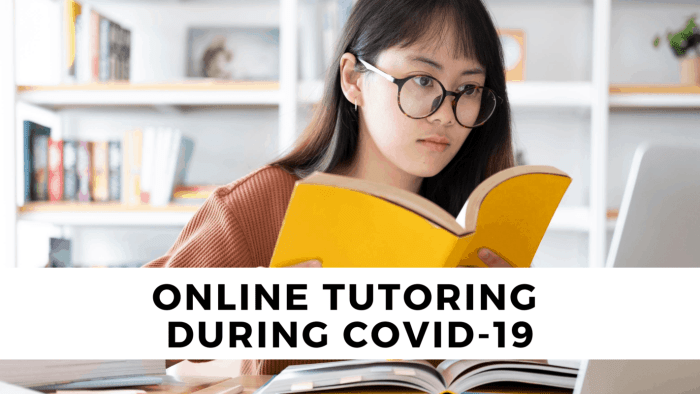 girl with glasses holding yellow book in session of online tutoring during covid-19