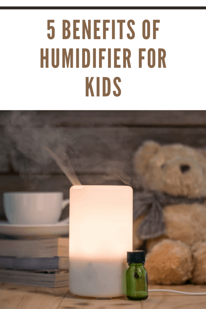 Ultrasonic humidifier on a wooden table, aroma maker in a home showing benefits of humidifiers for kids