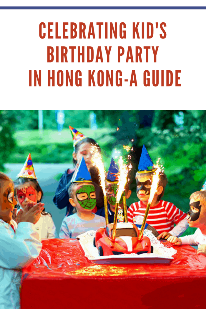 kids birthday party hong kong where kids faces are painted like superheros and they are gathered around cake.