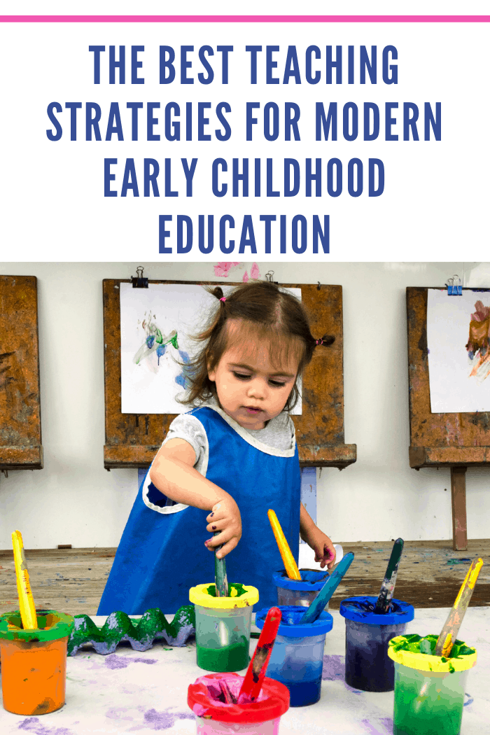 Adorable little girl painting and drawing as one of the best teaching practices for early childhood education