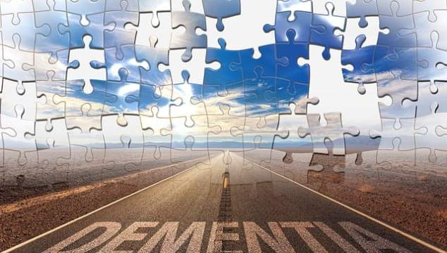 road leading into horizon with picture as a jigsaw puzzle and the word dementia on the bottom depciting problem solving and puzzle fun for the elderly with dementia