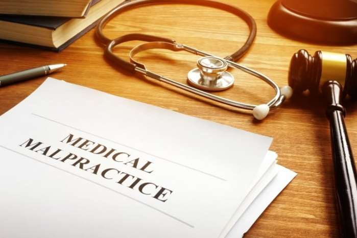 Medical malpractice report and stethoscope.