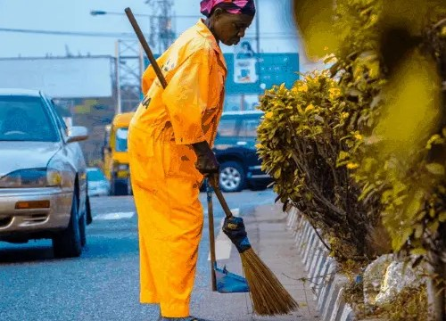 professional cleaning services cleaning curb with broom