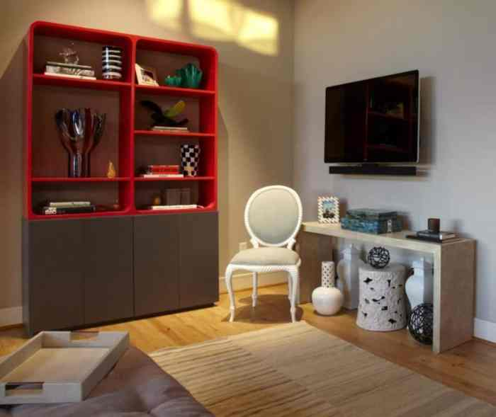 room with red bookshelf and chair in light