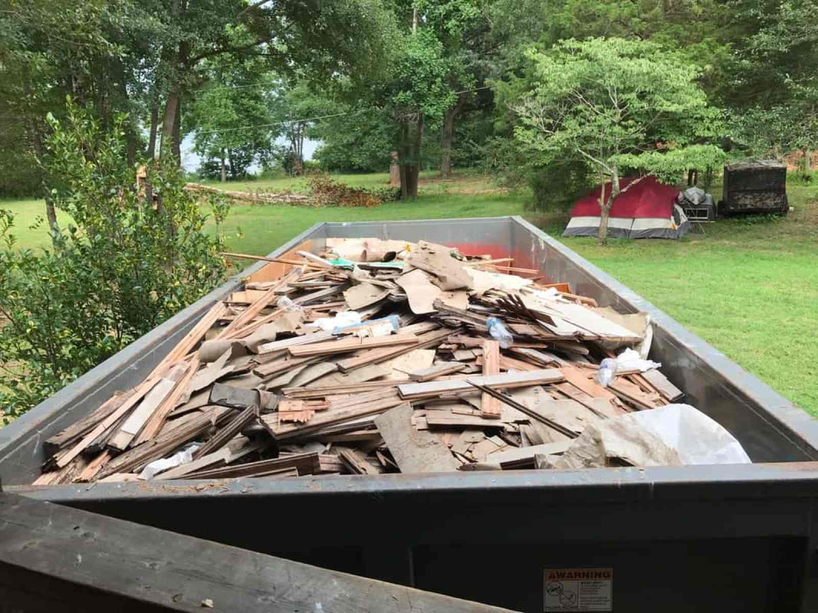 dad's house home remodel dumpster full