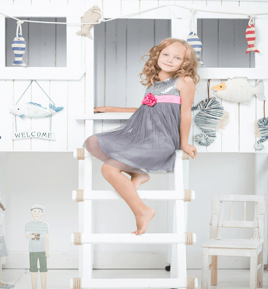 girl on ladder in nautical room