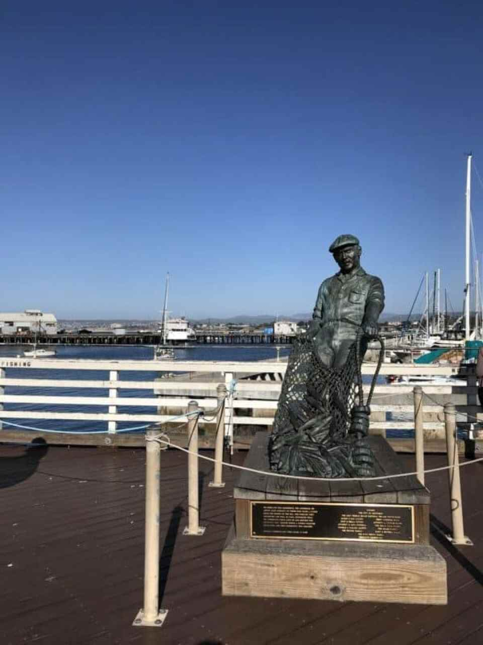 The-fisherman-statue-by-Jesse-Corsaut-Old-Fishermans-Grotto-Wharf-Monterey-CA