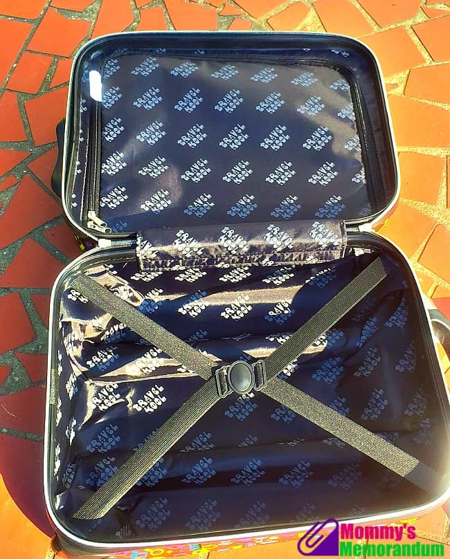 trendy kid inside suitcase