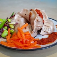 Steamed Momos and chilli sauce on a plate