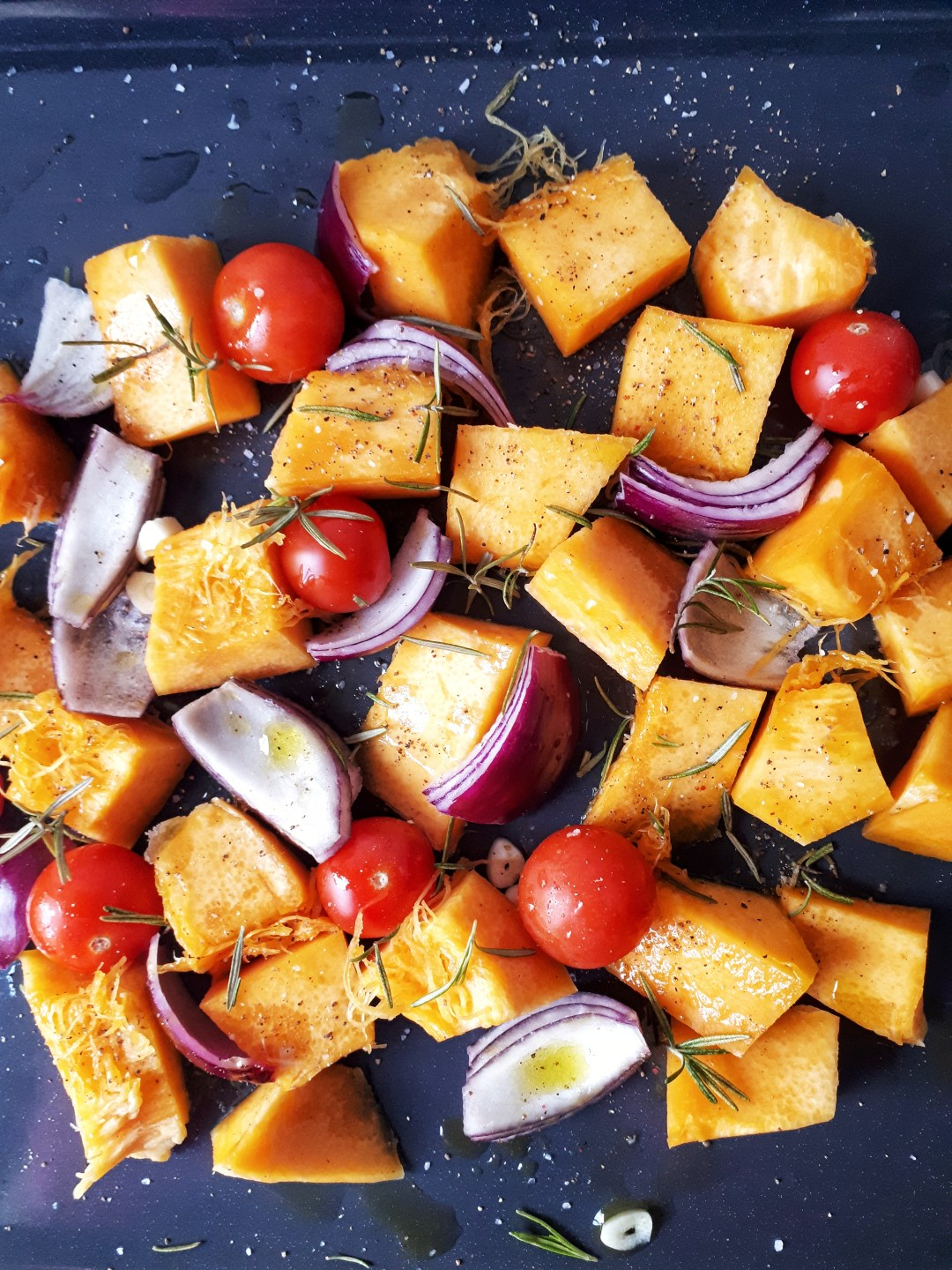 Roasted pumpkin is a simple, easy and versatile recipe that makes an amazing side dish.  This dish has a wonderful balance of pumpkin flavor with the rosemary and cherry tomatoes. This can be a paleo, keto and vegan recipe.