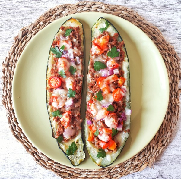 These fresh zucchini boats are stuffed with ground beef, topped with cheese and makes an amazing keto, low-carb and gluten-free meal. This is a healthy dinner recipe that all of your family is going to love!