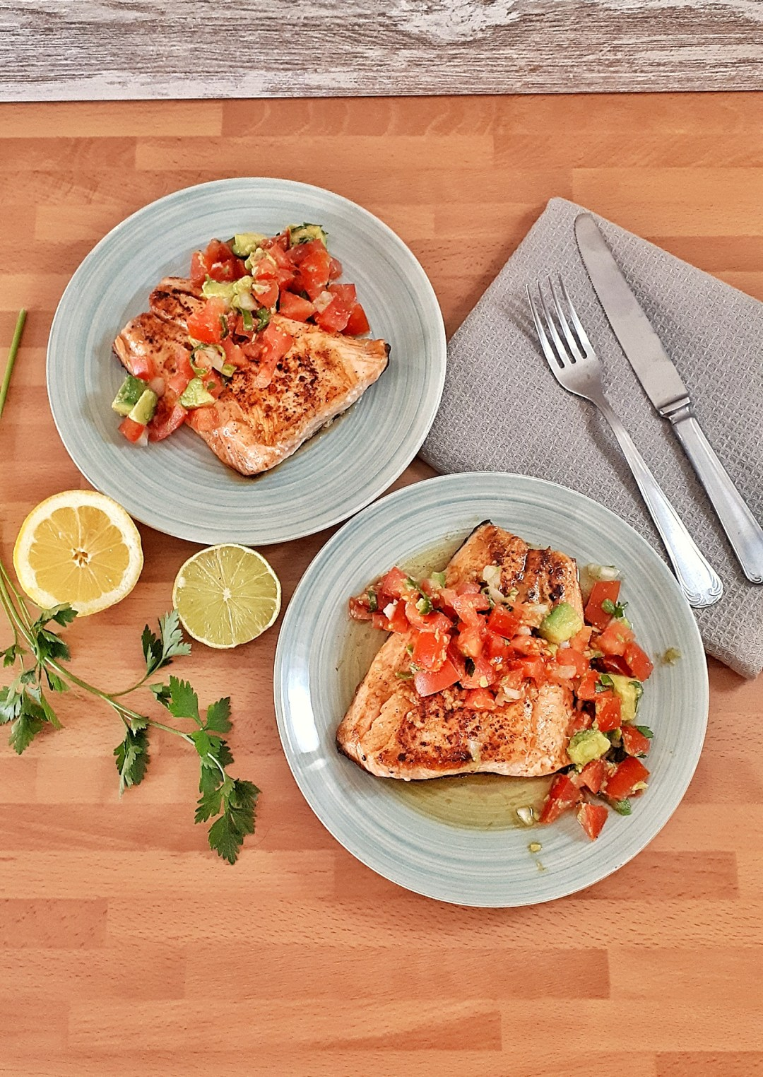 Keto salmon fillets are pan-seared are a healthy and simple dinner with a vibrant and rich lime tomato and avocado salsa. Simply irresistible!
