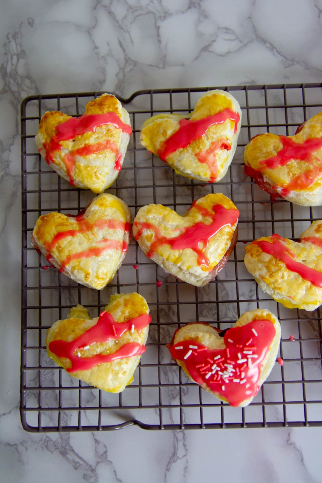 These Heart-Shaped Strawberry Nutella Hand Pies are exactly what you need for your special someone this Valentine's Day.