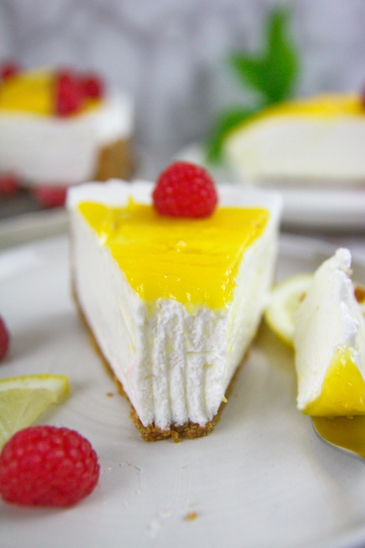 Keto Lemon Cheesecake is ultra-rich, creamy, and tangy topped with indulgent sugar-free lemon curd. Such a great dessert for spring and summer! #nobakecheesecake #ketocheesecake