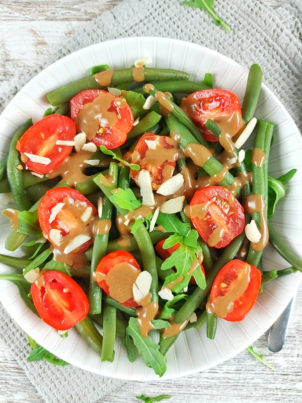 This Green Bean and tomato salad is fresh, crisp, and bursting with flavor! Green Bean and Tomato Salad is a summer treat that's low-carb, gluten-free, and vegan!