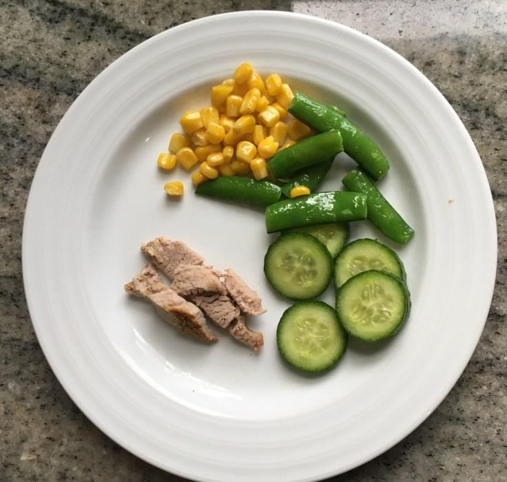 Corn, snap peas, cucumber with roast pork tenderloin kids plate