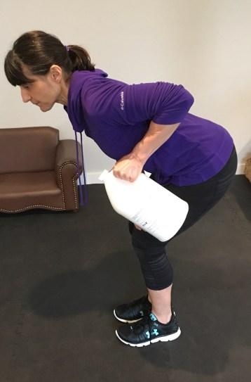 Alternate bent row, lifting weight