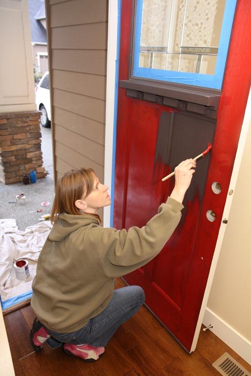 Painting a front door.