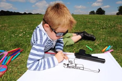 boy-drawing-picture-of-gun