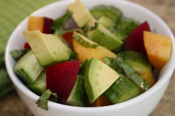 The fresh flavors of avocado and peach come together with a light basil dressing to make a simple, summer salad.