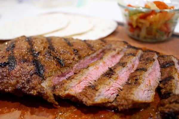 Grilled Garlic Lime Flank Steak takes Taco Tuesday to a whole new level with simple ingredients and a flavorful marinade. Top with fresh veggies and salsa and you have yourself one healthy meal!