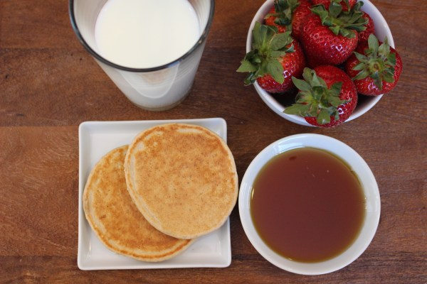 An easy and easy and healthy recipe for whole wheat oatmeal pancakes. Make a big batch, freeze, then reheat for busy mornings!