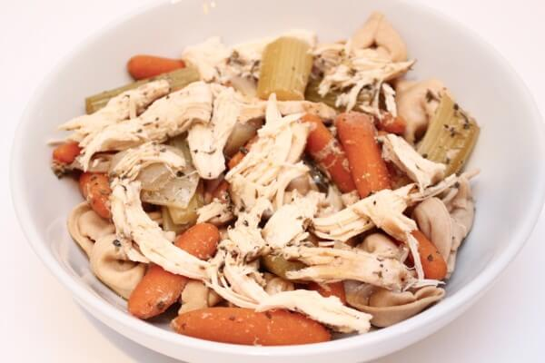 1 pound boneless, skinless chicken breast 1 tablespoon Italian seasoning 2 cups baby carrots 3 stalks celery, cut into thirds 1 medium onion, roughly chopped 2 cloves garlic, minced 1 bay leaf 1 cup chicken broth pepper to taste 1 package whole wheat tortellini