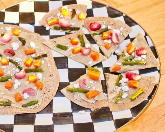 Roasted Vegetable and Hummus Flatbread makes an easy after-school snack that's customizable based on your family's favorite roasted veggies!