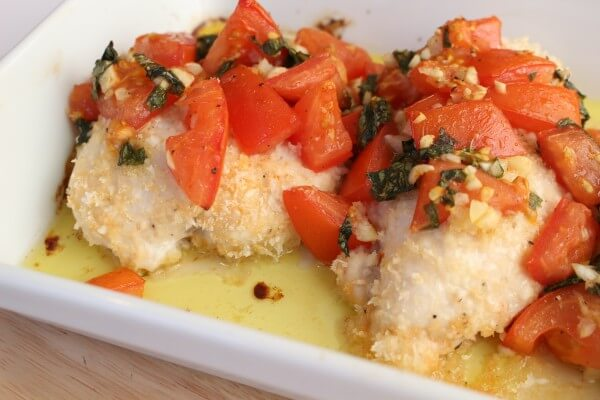 Baked bruschetta chicken breasts are lightly breaded in crunchy panko breadcrumbs and topped with the classic mixture of fresh tomatoes, basil, and garlic.