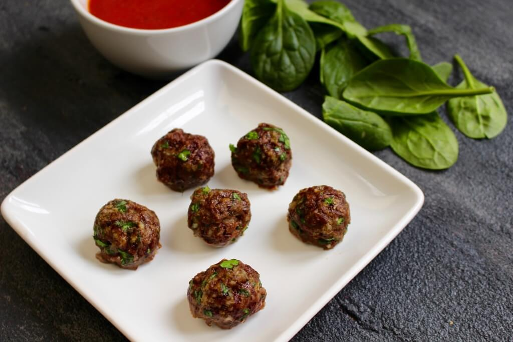 Baked mini meatballs are a staple protein source that can be used in a variety of dishes, like spaghetti, pizza, soup, and sandwiches.