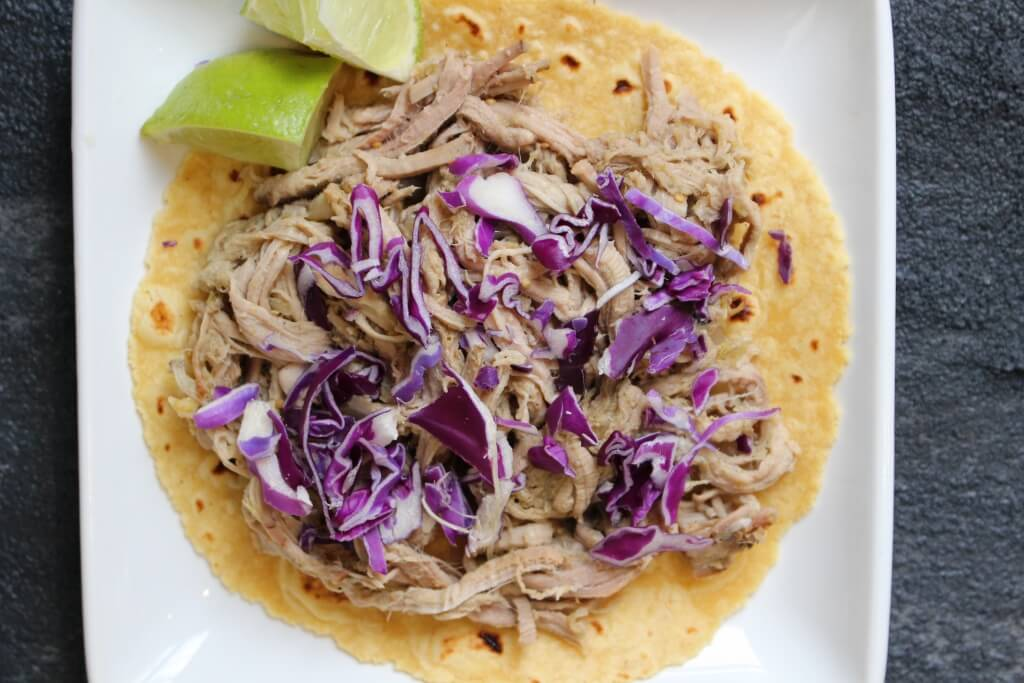 3-Ingredient Pulled Pork Tacos are juicy, flavorful, and made with pantry staples. Top with your favorite taco toppings or skip the tortilla and serve on a bed of brown rice.