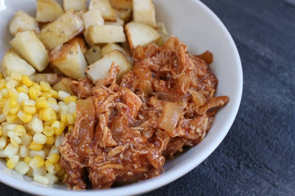 BBQ Chicken Bowls with slow cooked BBQ chicken, onions, roasted potatoes and corn make a simple make-ahead meal that are easily reheated for any busy weeknight.