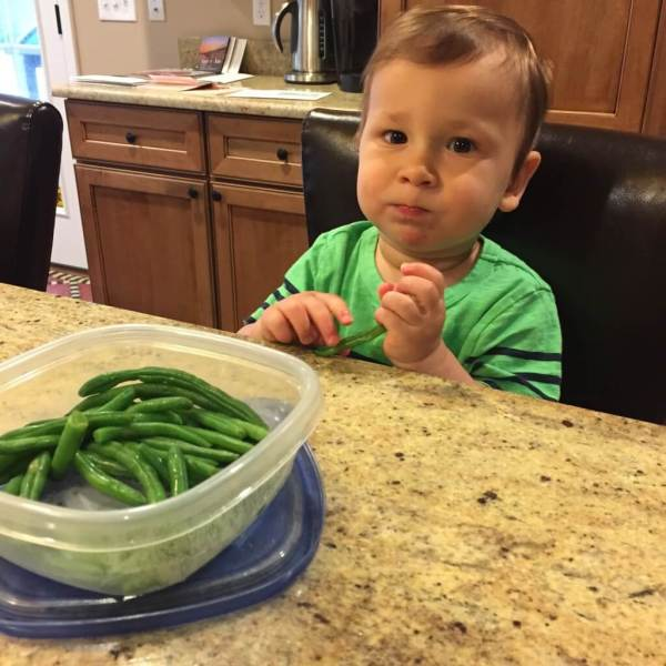 One of my favorite pictures of Joey post nap. He wanted a snack and Mom pulled out the washed and steamed green beans for snacking. He ate a few.... which is more than I could have asked for!