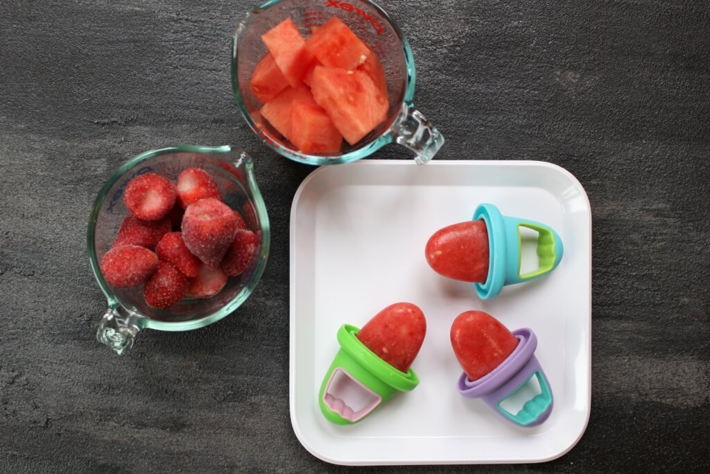 These watermelon popsicles are made with fresh and frozen fruit and zero added sugar, making the perfect healthy refreshing treat for any hot summer day! I don't know what it is about watermelon and being pregnant, but some crazy watermelon craving comes over me when I've got a baby in my uterus. And since that's been the case the past three years, you better believe I've consumed enough watermelon to feed a small army. Summer or not, my boys have always gravitated towards the sweet, water-filled fruit as well. So when the idea for these watermelon popsicles came to mind I knew that if I perfected my recipe, we'd be enjoying watermelon popsicles for years to come! I wasn't sure if I needed to do a formal post for these watermelon popsicles as I already shared the how-to for them on Instagram and in my recent 10 Homemade Popsicles for Summer blog post. But since I'm practically dreaming and bathing in watermelon right now [c/o my 36th week of pregnancy], I figured why not talk about them some more! While we are happy campers just snacking on a bowl filled with sliced watermelon, there's something to be said about using it in other recipes. Like all fruit, watermelon is naturally sweet and makes a great dessert or snack. Next time you want to serve up a kid-pleasing and healthy dish, think watermelon! Side note: Watermelon is 92% water--- making it a delicious hydrator. Chances are that's why pregnant women and